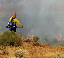 Fireman fighting a brush fire in the southwest