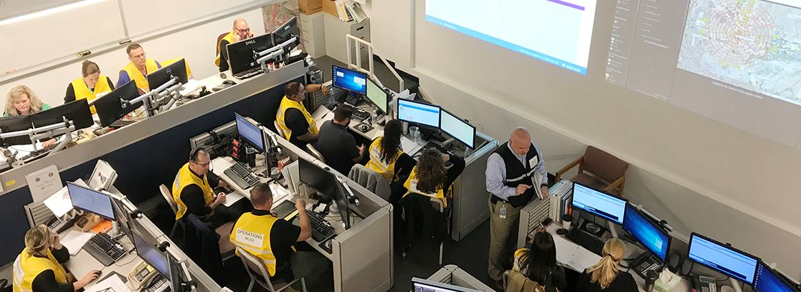 Emergency Operations staff at different stations in the Maricopa County Emergency Operations Center